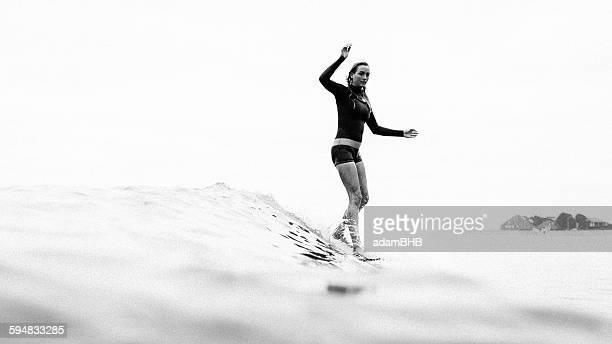 Woman surfing, Malibu, California, USA