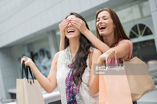 Woman surprising a friend at the shopping center