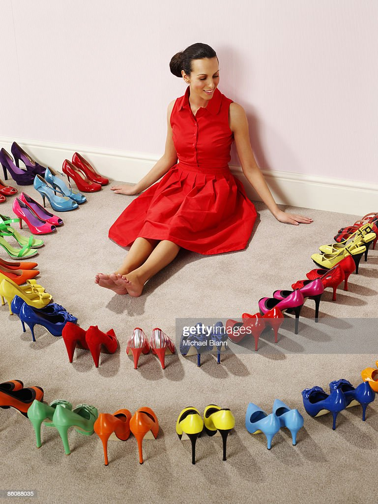 Woman surrounded by perfect shoes
