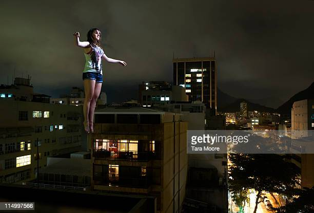 woman suspended in mid air in city