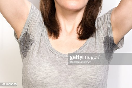 Woman sweating very badly under armpit : Stock Photo