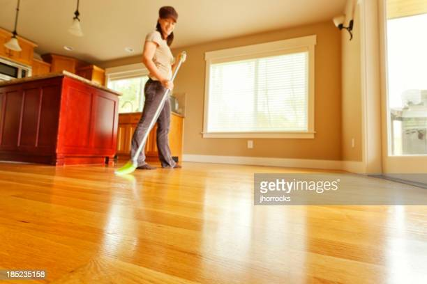 Woman Sweeping Hardwood Floor with Broom