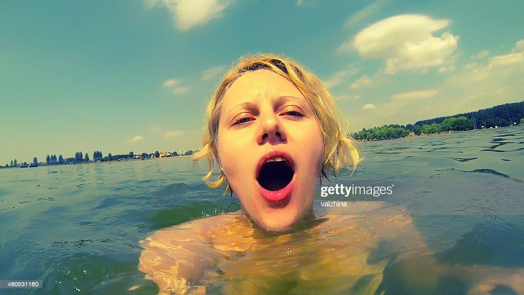 woman swimming in a lake : Stock Photo