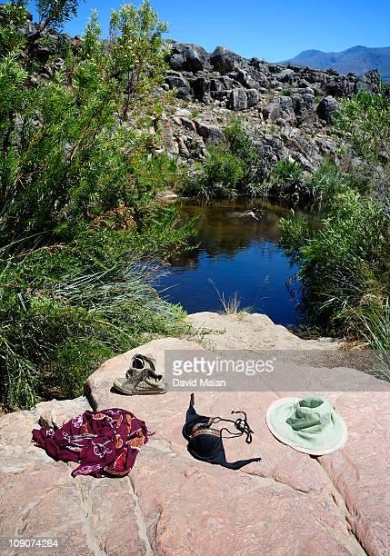 Woman swimming in a rock pool.