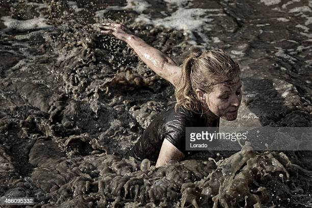 woman swimming in dirty water
