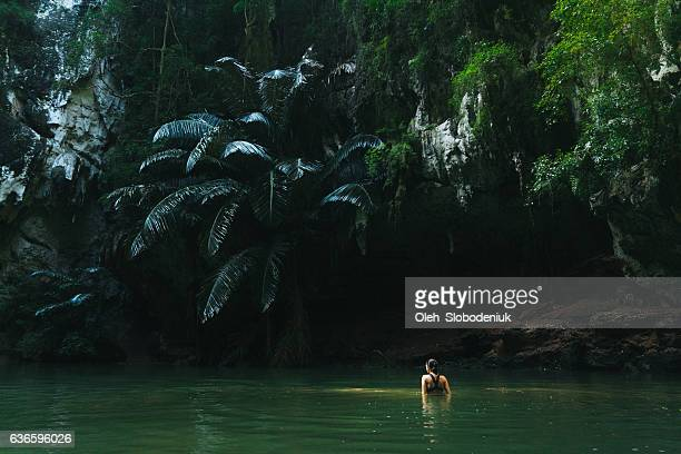 Woman swimming in lagoon