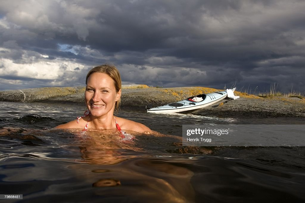 A woman swimming in the archipelago.