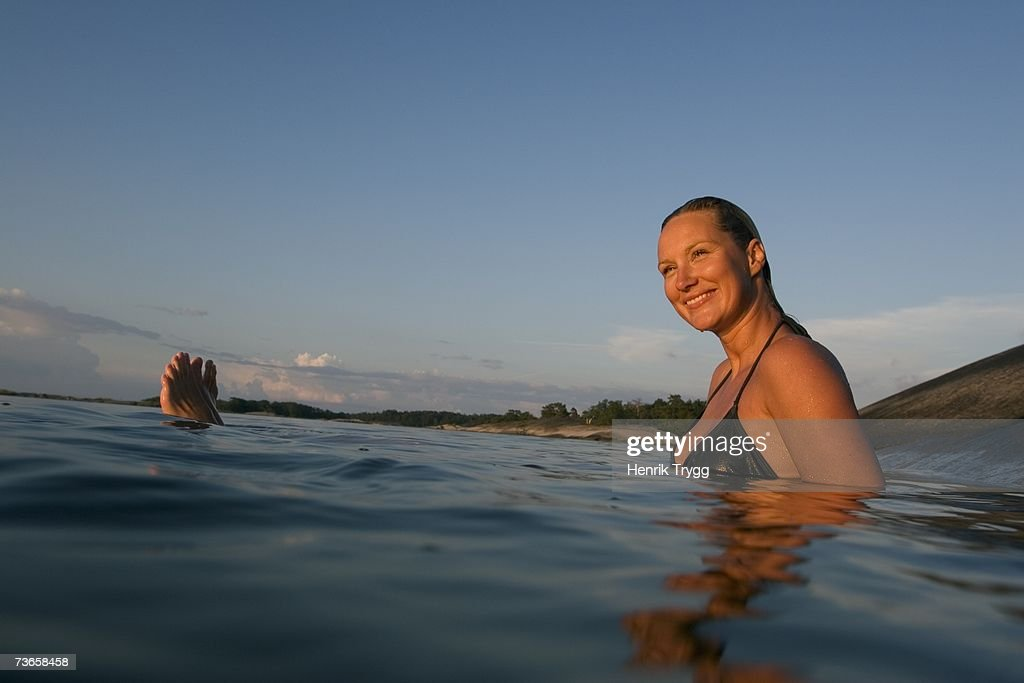 A woman swimming in the archipelago. : Stock Photo