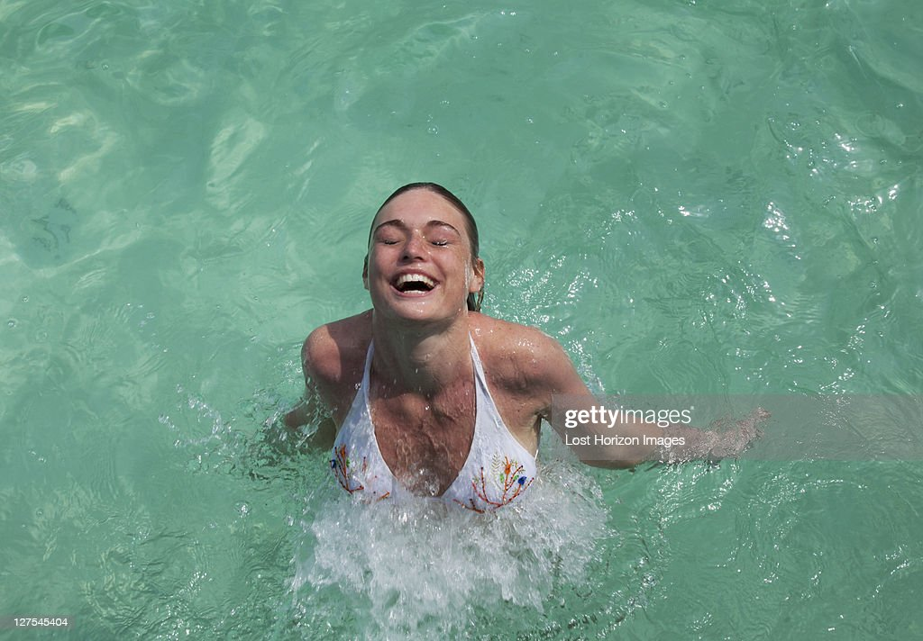 Woman swimming in tropical sea