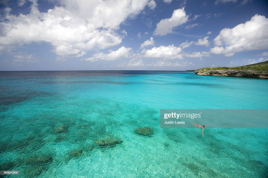 Woman swimming in turquoise Caribbean water : Stock Photo