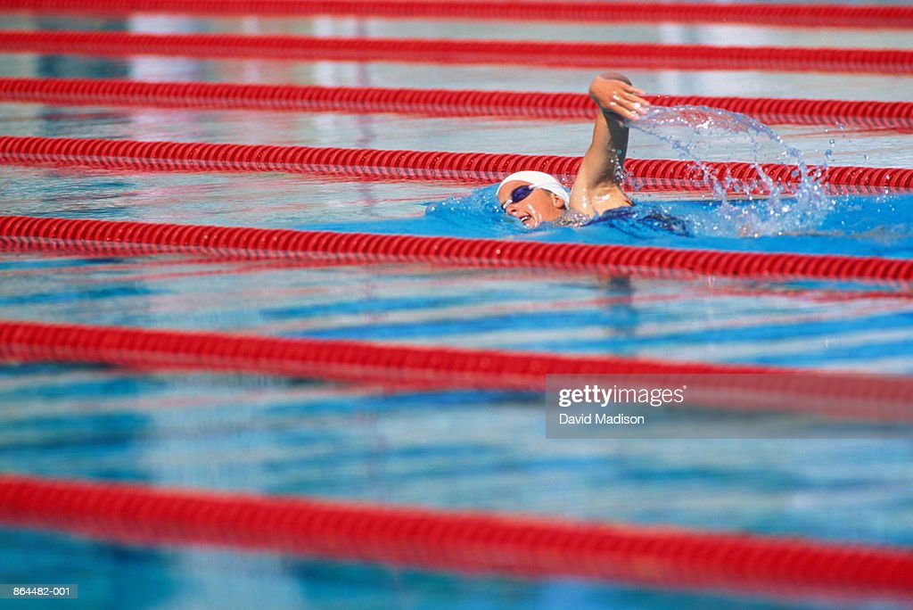 Woman Swimming Lengths In Pool Stock Photo Getty Images