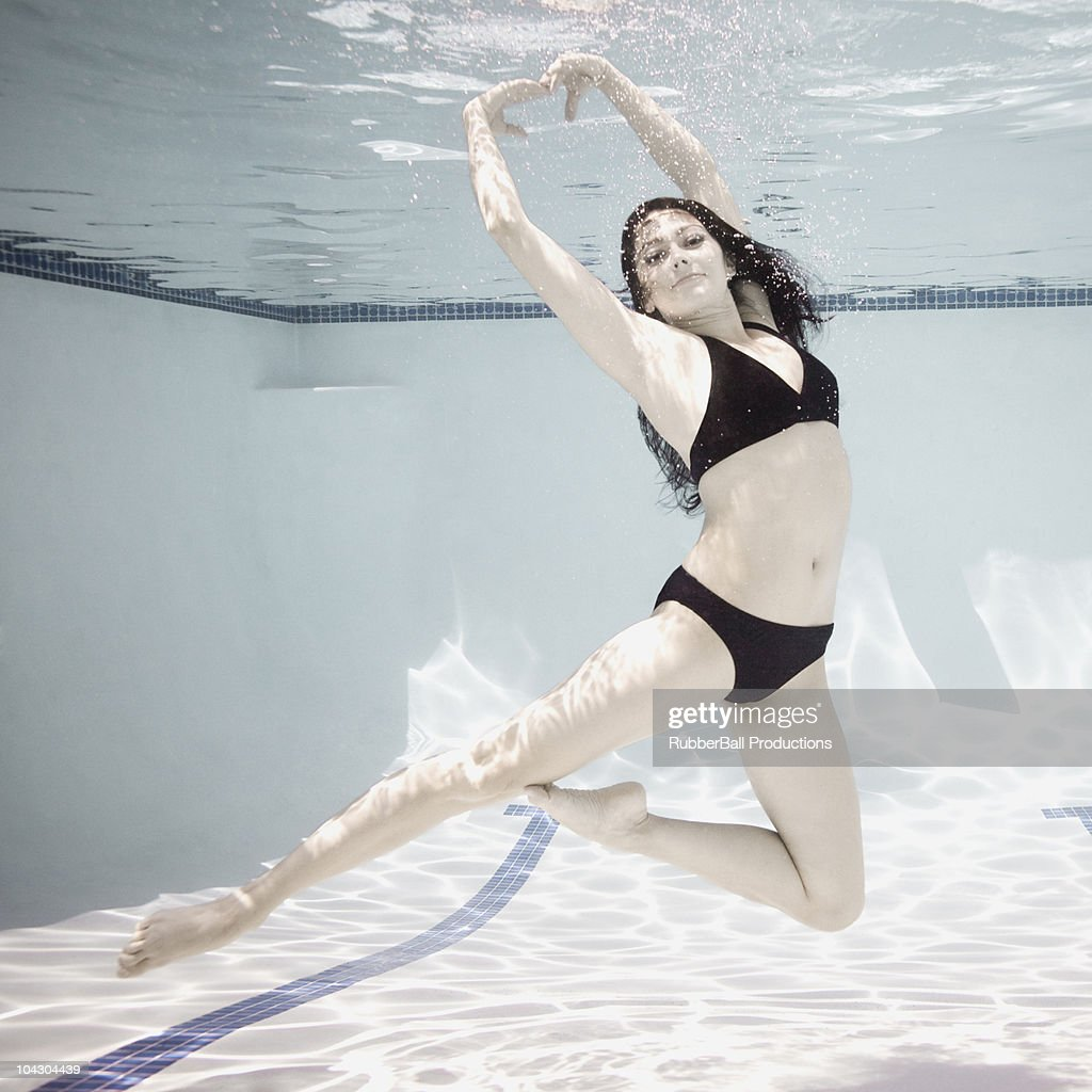 woman swimming underwater in a pool : Stock Photo