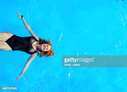 woman swimming water