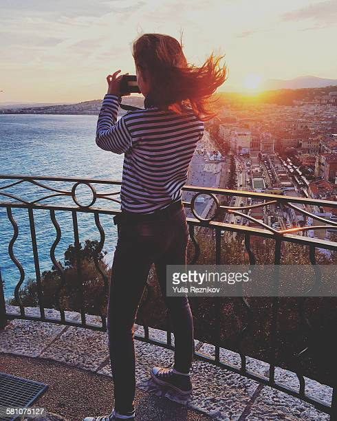 Woman take a picture from panoramic view point