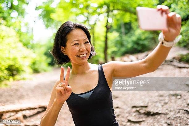 woman take a selfie on the wood during the jogging