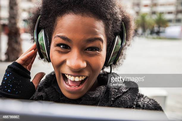 Woman take a selfie while listening to music on headphones