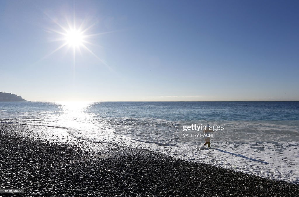 A woman takes a bath in the Mediterranean sea on February 13, 2013 in the southeastern French city of Nice.