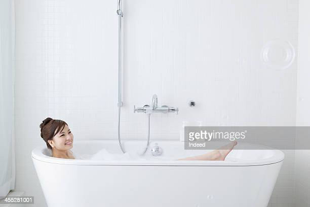 Woman takes a bath
