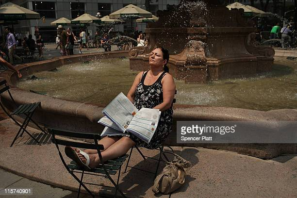 A woman takes a break in Bryant Park during a heat wave on June 9 2011 in New York City With the high today in Central Park expected to reach 99...