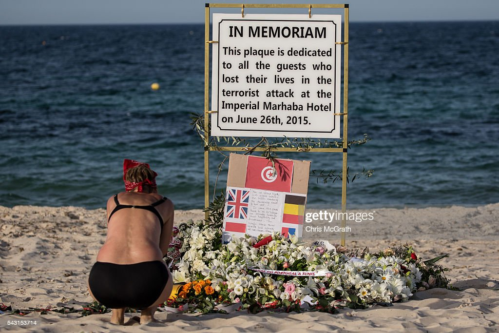 A woman takes a moment to remember the victims of the 2015 Sousse Beach terrorist attack at a memorial sign on the beach in front of the Imperial Marhaba hotel on June 26, 2016 in Sousse, Tunisia. Today marks the one year anniversary of the Sousse Beach terrorist attack, which killed 38 people including 30 Britons. Before the 2011 revolution, tourism in Tunisia accounted for approximately 7% of the countries GDP. The two 2015 terrorist attacks at the Bardo Museum and Sousse Beach saw tourism numbers plummet even further forcing hotels to close and many tourism and hospitality workers to lose their jobs.