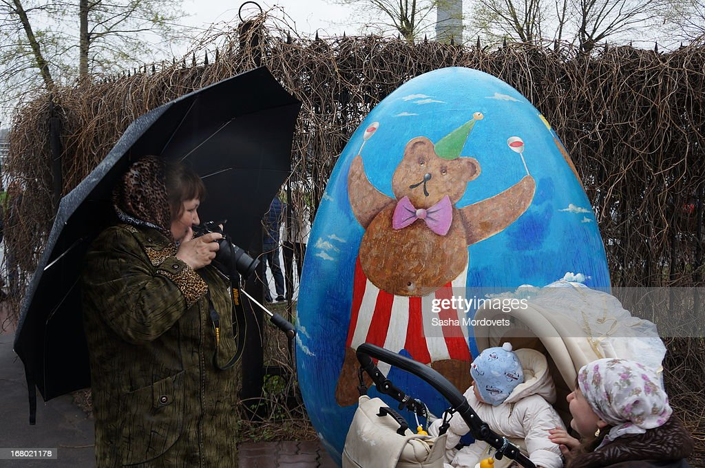 A woman takes a photo during celebration of the Orthodox Easter in the Trinity Church May,4, 2013 in Moscow, Russia. Thousands of Russian Orthodox Church belivers attend the Easter celebrations in Moscow.