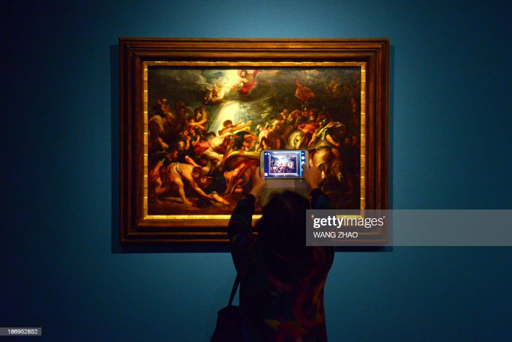 A woman takes a photo in front of Peter Paul Rubens' 'The Conversion of St Paul' as she visits an exhibition at China's National Museum in Beijing on November 5, 2013. Royal collections of Liechtenstein, including works by Rubens, Van Dyck and other Flemish painters, are being held at China's National Museum from November 5, 2013 to February 15, 2014. AFP PHOTO / WANG ZHAORESTRICTED TO EDITORIAL USE, MANDATORY MENTION OF THE ARTIST UPON PUBLICATION, TO ILLUSTRATE THE EVENT AS SPECIFIED IN THE CAPTION