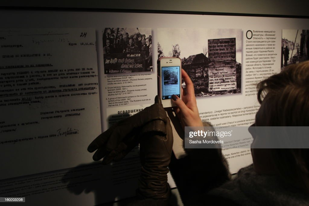 A woman takes a photo in the renovated Russian exposition in the museum at the former Auschwitz Birkenau Nazi concentration camp January 27, 2013 near Oswiecim, Poland. A ceremony marked the 68th anniversary of the liberation of the camp during International Holocaust Remembrance Day.