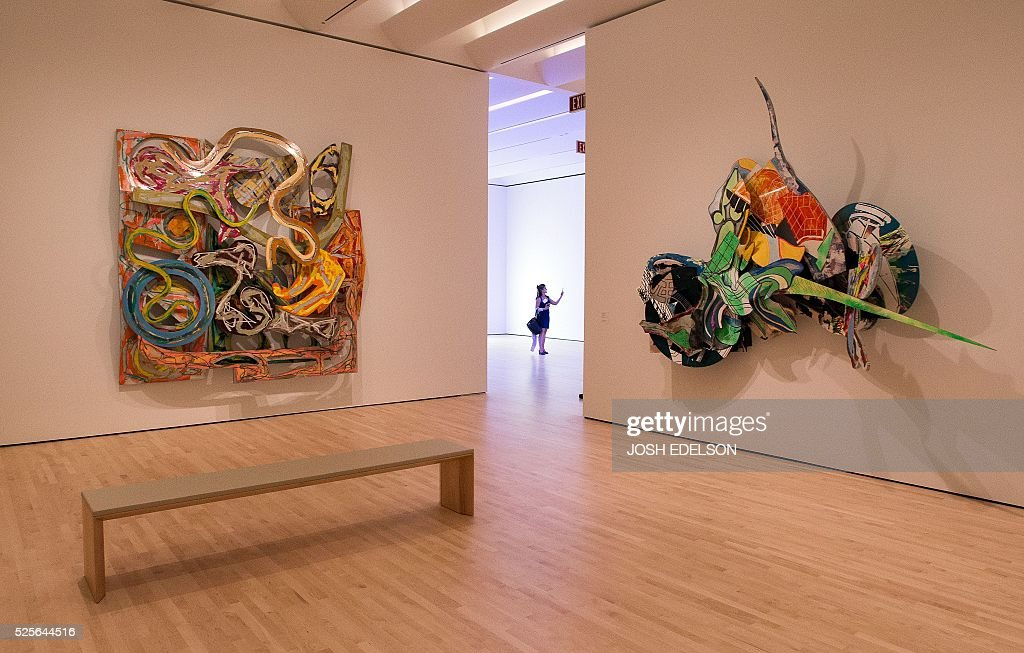 A woman takes a photo inside the San Francisco Museum of Modern Art (SFMOMA) in San Francisco, California on April 28, 2016. The newly redesigned museum integrates a 10-story expansion in a new building and will open to the public on May 14, 2016. / AFP / Josh Edelson / RESTRICTED
