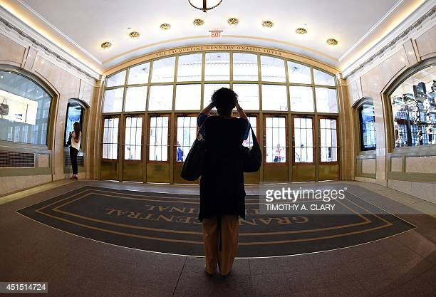 A woman takes a photo of the nameplate of Jacqueline Kennedy Onassis after a ceremony June 30 2014 to dedicate Grand Central Terminal's renovated...
