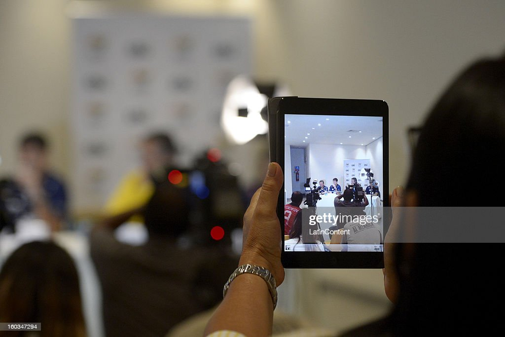 A woman takes a picture during the first official training season of the team, who will represent Brazil in the Olympic Games Rio 2016, at Maria Lenk Aquatic Center on January 29, 2013 in Rio de Janeiro, Brazil.