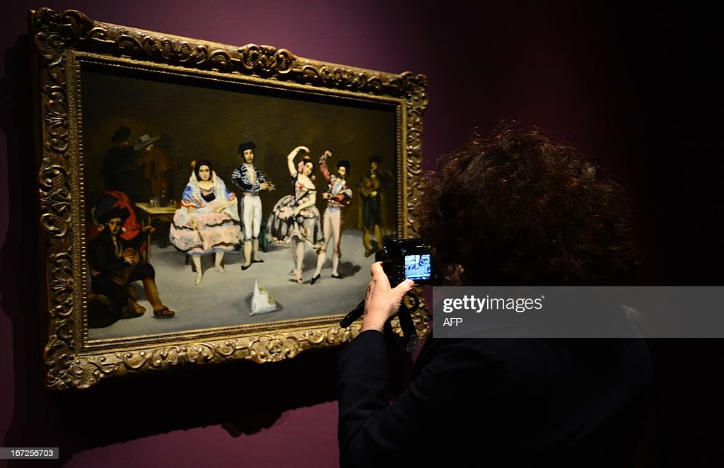 A woman takes a picture of a painting made by Edouard Manet on April 23,2013 in Venice, as she visits the exhibition 'Manet Return to Venice', which runs until August 18, 2013, at the Doge'S Palace in Venice. Edouard Manet's 'Olympia' will be appearing alongside the Titan's 'Venus of Urbino' a masterpice of Renaissance and source of inspiration for the French artist.