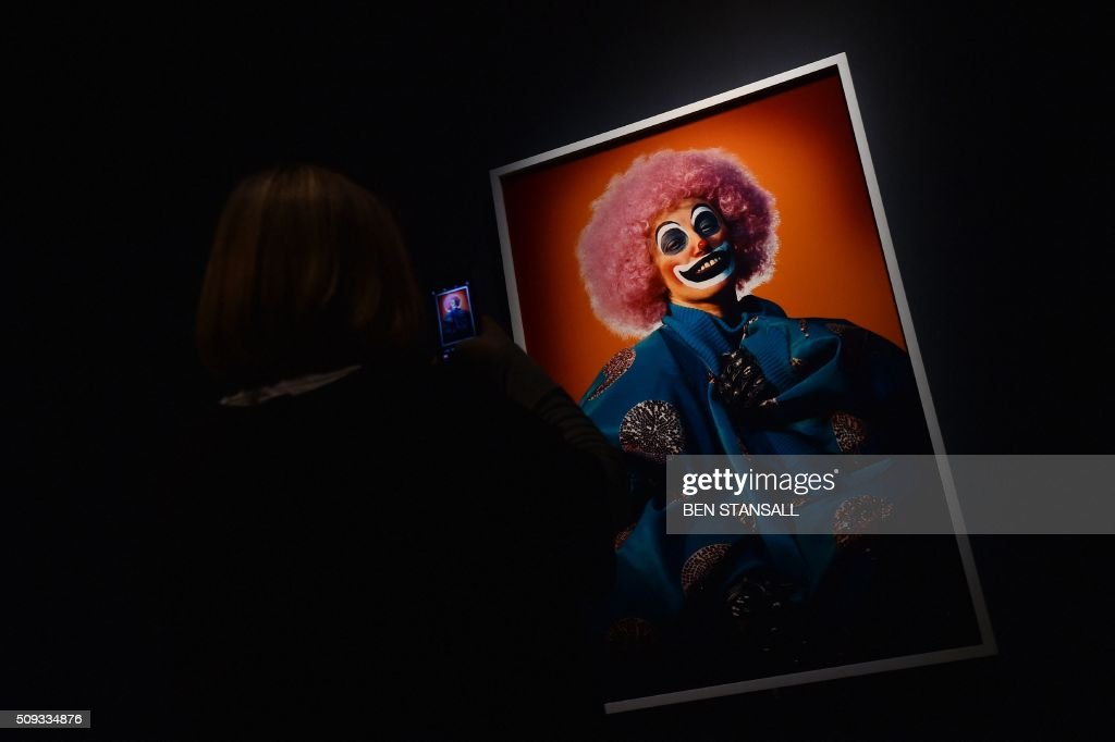 A woman takes a picture of a photograph by Cindy Sherman entitled 'What Lies Beneath' 2003 as part of the 'Vogue 100 a Century of Style' exhibition at the National Portrait Galley in central London on February 10, 2016. The exhibition showcases a range of photography commissioned by British Vogue since it was founded in 1916. / AFP / BEN STANSALL / RESTRICTED TO EDITORIAL USE - MANDATORY MENTION OF THE ARTIST UPON PUBLICATION - TO ILLUSTRATE THE EVENT AS SPECIFIED IN THE CAPTION
