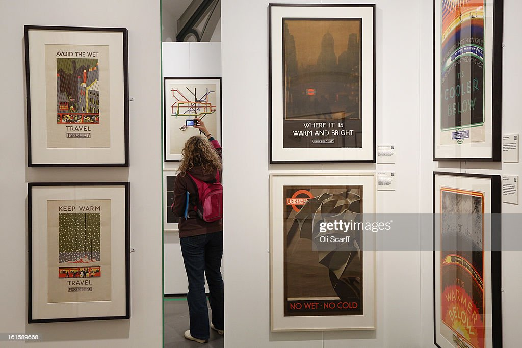 A woman takes a picture of a poster in the exhibition 'Poster Art 150 - London Underground's Greatest Designs' in the London Transport Museum on February 12, 2013 in London, England. The exhibition celebrates 150 years of the London Underground by showcasing 150 posters from the Museum's archive of over 3,300. The exhibition opens on February 15, 2013 and runs until October 27, 2013.