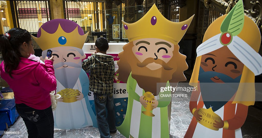 A woman takes a picture of her son as he posts a letter to the Three Kings at the main post office in Mexico City on January 4, 2013. In Spanish-speaking parts of the world, children believe that the Three Kings receive their letters and so bring them gifts on the night before Epiphany. The Mexican Post Office opened this service to encourage the use of traditional mail. AFP PHOTO/OMAR TORRES