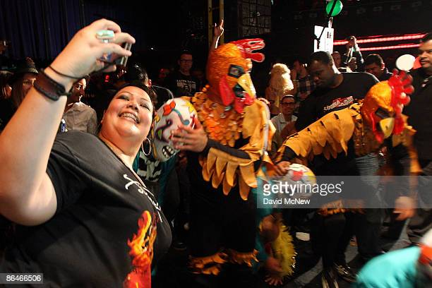 ANGELES CA � A woman takes a picture of herself after Los Cavaleros and Crazy Chickens lucheros traditional Mexican wrestlers flew over the ropes and...