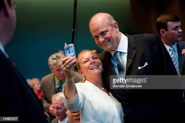 A woman takes a picture of herself with actor and lawyer Fred Thompson during the Republican Party of Virginia's 2007 Commonwealth Gala June 2 2007...