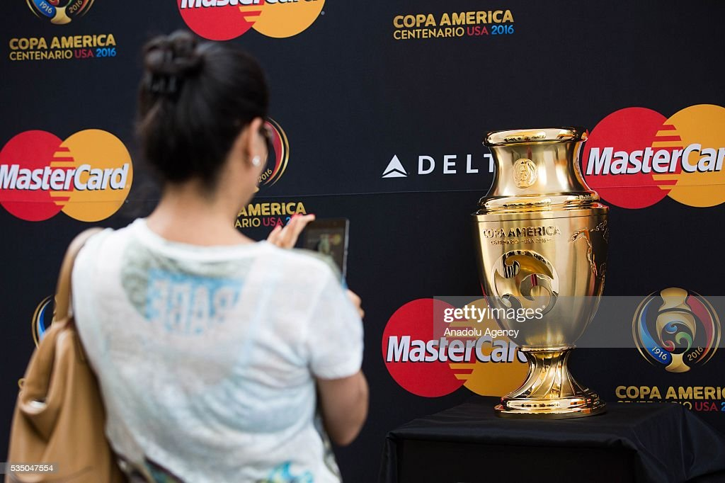 A woman takes a picture of the Copa America Centenario Trophy during the Trophy Tour in Mexico City, Mexico on May 28, 2016. Copa America Centenario will be held in the United States from June 3 to 26, will also be the first time that the Copa America will be contested outside South America.