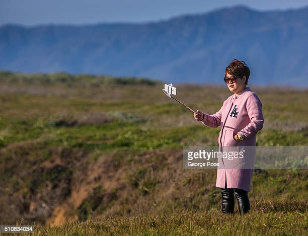 A woman takes a selfie along the bluffs overlooking the Pacific Ocean on February 4 near the Piedras Blancas Lighthouse California Because of its...