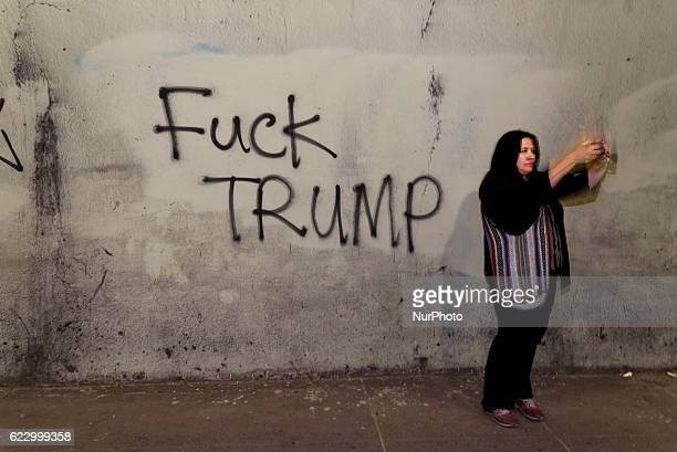 Woman takes a selfie during antiTrump protest in Los Angeles California November 12 2016 According to the LAPD an estimated crowd of nine thousand...