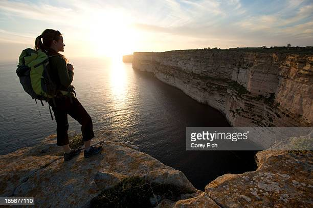 A woman takes in the view while on a sport climbing trip in Malta.