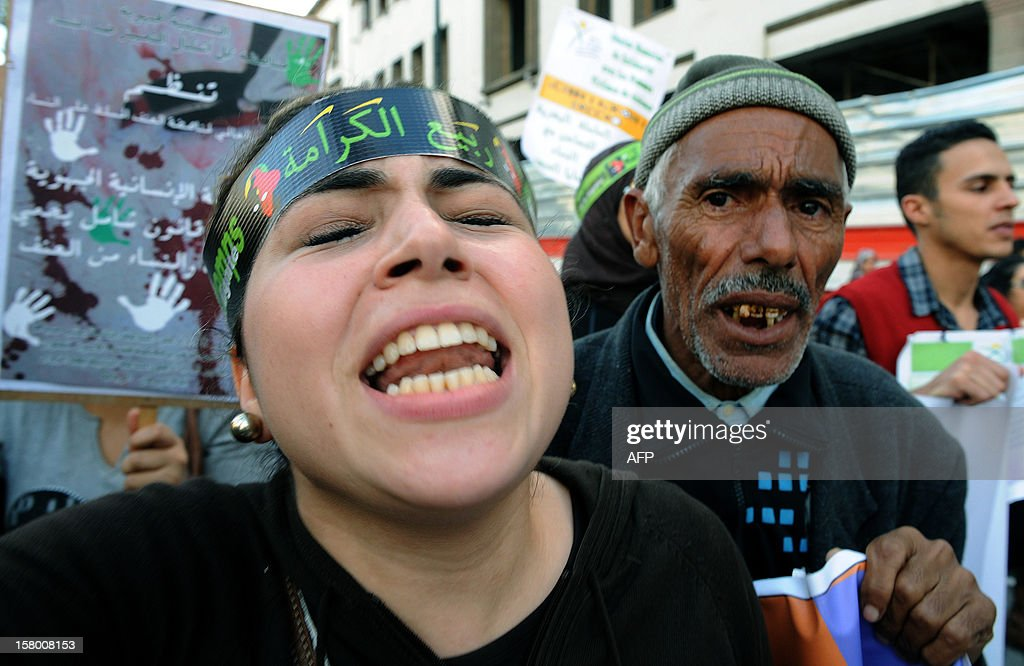 A woman takes part in a protest in the Moroccan city of Rabat on December 8, 2012, as hundreds of people formed a human chain denouncing all forms of violence against women, an AFP correspondent reported.