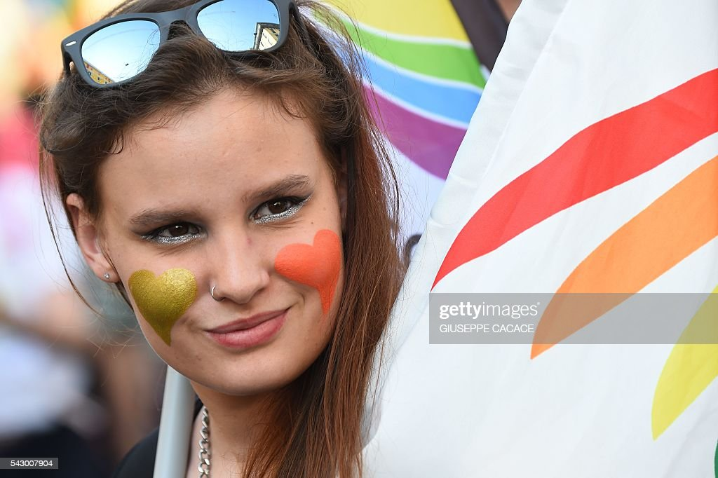 A woman takes part in the annual Lesbian, Gay, Bisexual and Transgender (LGBT) Pride Parade in Milan, on June 25, 2016. / AFP / GIUSEPPE