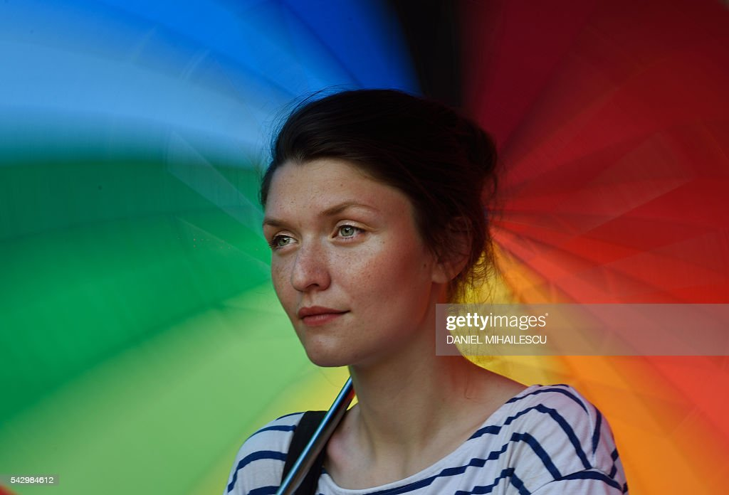 A woman takes part in the Bucharest Pride, an event celebrating diversity and LGBT community in Bucharest on June 25, 2016. / AFP / DANIEL