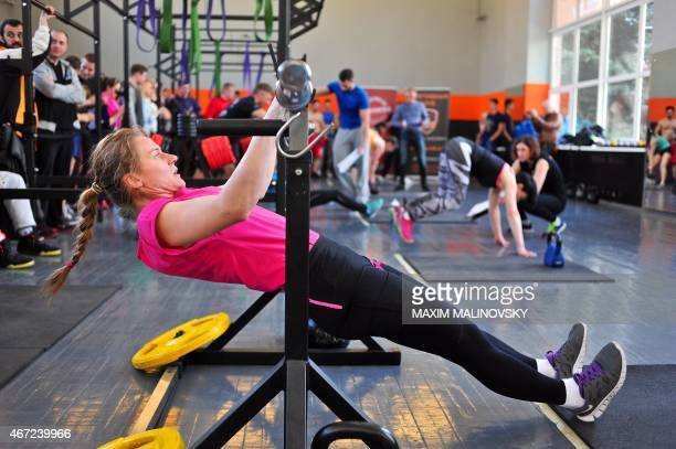 A woman takes part in the National semifinal crossfit competition in Belarus' capital of Minsk on March 22 2015 AFP PHOTO / MAXIM MALINOVSKY