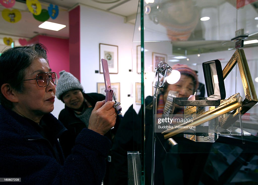 A woman takes photograph piece of diamond shape chocolate with a 2.3 carat diamond in the centre on display at a Hanshin Department Store on February 6, 2013 in Osaka, Japan. The chocolate is priced at 3 million yen (about USD 32,456), making it the world's most expensive chocolate.