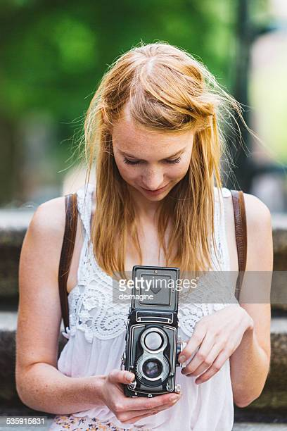 Woman takes photos with old camera