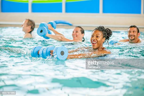 Woman Taking a Aerobic Fitness Class in the Pool