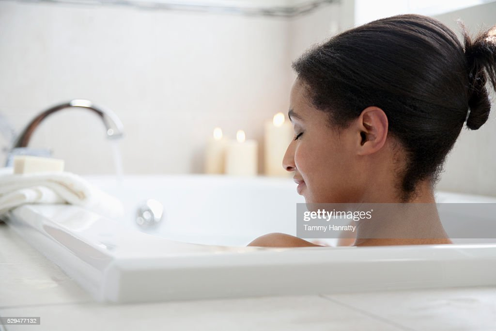 Woman taking a bath : Foto de stock