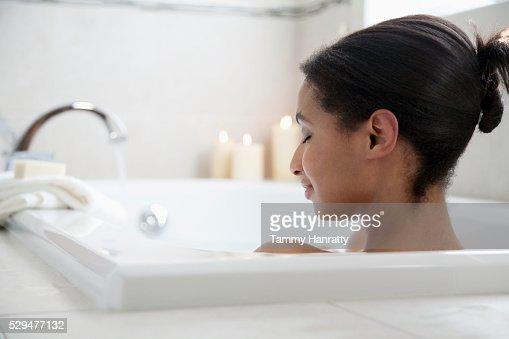 Woman taking a bath : Stockfoto