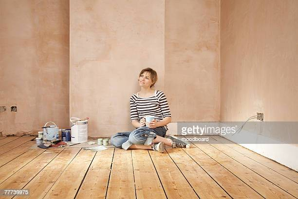 Woman Taking a Break From Painting Room
